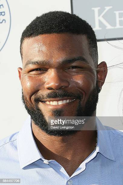Baseball player Howie Kendrick arrives at the Los Angeles Dodgers Foundation Blue Diamond Gala at the Dodger Stadium on July 28 2016 in Los Angeles...