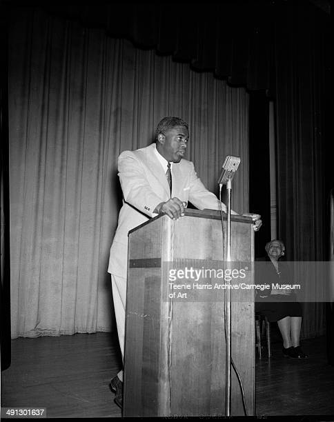 Baseball player Jackie Robinson speaking at podium at NAACP fiftieth anniversary event Pittsburgh Pennsylvania circa 1959