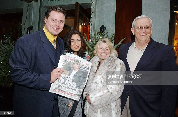 Baseball player Jason Giambi exits a restaurant after lunch with his girlfriend Kristian Rice his mother Janey and father John December 13 2001 in...