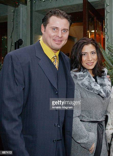 Baseball player Jason Giambi exits a restaurant after lunch with his girlfriend Kristian Rice December 13 2001 in New York City Giambi is on his way...