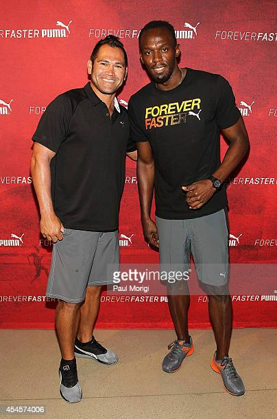 Baseball player Johnny Damon and Olympic sprinter Usain Bolt pose for a photo at The PUMA Store In Soho Forever Faster Training Event on September 3...