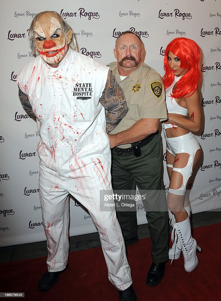 Baseball player Jose Conseco, actor Al Burke and model/actress Leila Knight arrive for the CD Release And Halloween Costume Party For Lunar Rogue on October 26, 2013 in Beverly Hills, California.