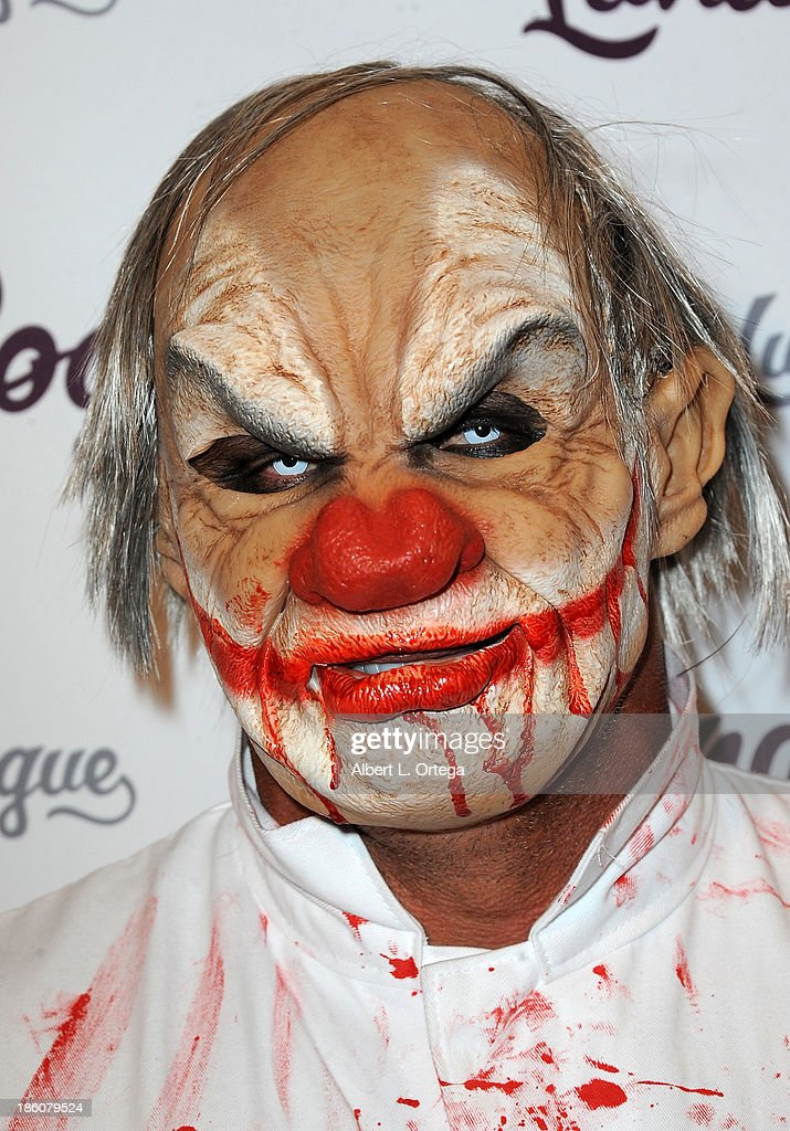 Baseball player Jose Conseco arrives for the CD Release And Halloween Costume Party For Lunar Rogue on October 26, 2013 in Beverly Hills, California.