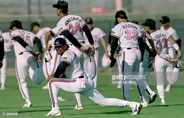 US baseball player Julio Franco stretches with his Japanese teammates on the Chiba Lotte Marines 16 February as they train at the Peoria Sports...