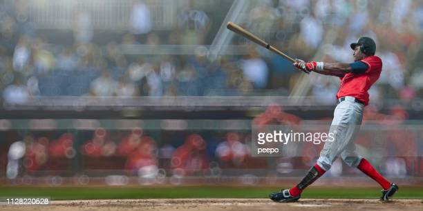baseball player just hit ball during game in outdoor arena - batting stock pictures, royalty-free photos & images