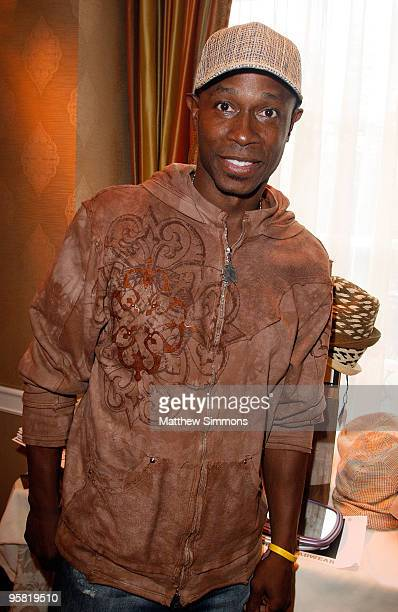Baseball player Kenny Lofton poses at the Block Headwear display during the HBO Luxury Lounge in honor of the 67th annual Golden Globe Awards held at...