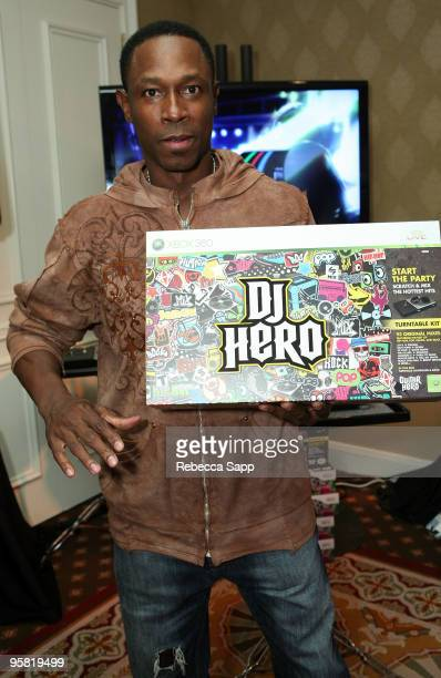 Baseball player Kenny Lofton visits the Activision display during the HBO Luxury Lounge in honor of the 67th annual Golden Globe Awards held at the...
