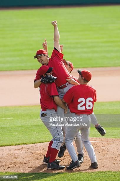 Baseball player lifting the pitcher