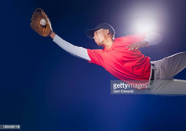 baseball player lunging for ball - diving to the ground stock pictures, royalty-free photos & images