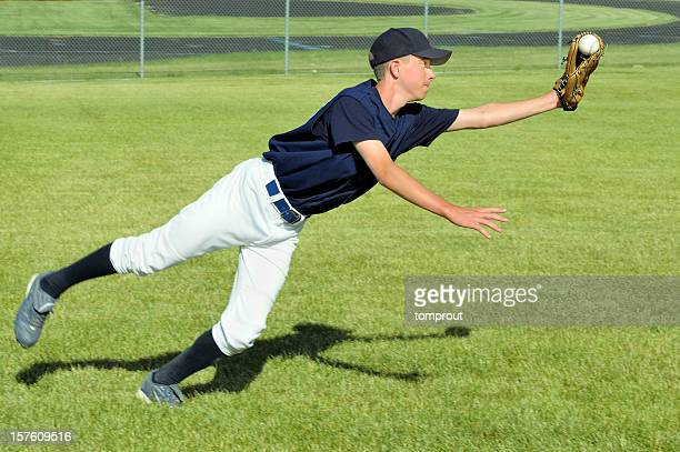 baseball player makes a diving catch - catching stock pictures, royalty-free photos & images
