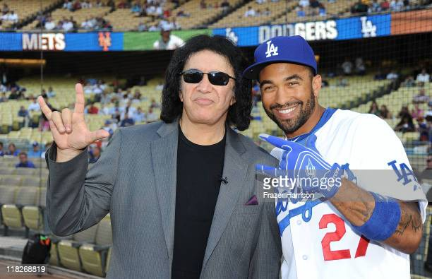 Baseball player Matt Kemp poses with musician Gene Simmons at the Dodgers v Ny Mets game where he threw to out the first pitch of the game at Dodger...
