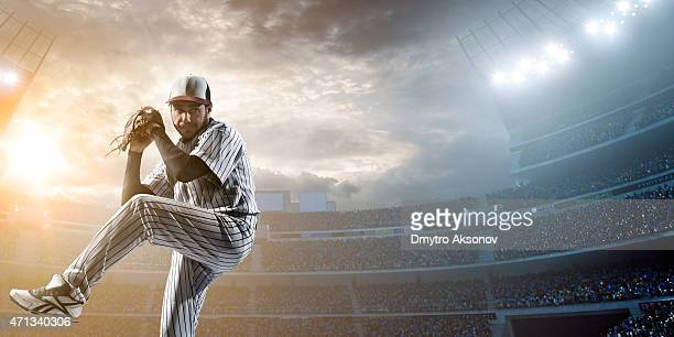 baseball player pitching a ball in a stadium - baseball player stock pictures, royalty-free photos & images