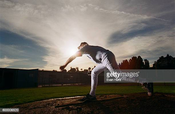 baseball player pitching - baseball pitcher stock pictures, royalty-free photos & images