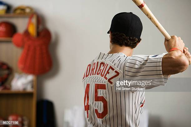 Baseball Player Practicing Swing In Locker Room