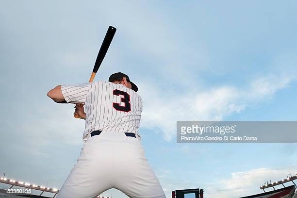 Baseball player preparing to bat, rear view
