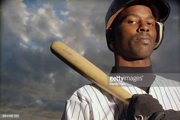 Baseball Player Resting Bat on Shoulder