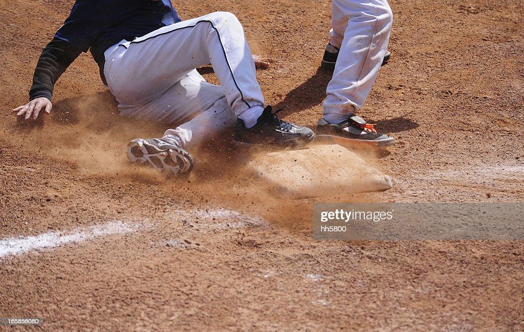 Baseball Player running  sliding Into Base : Stock Photo