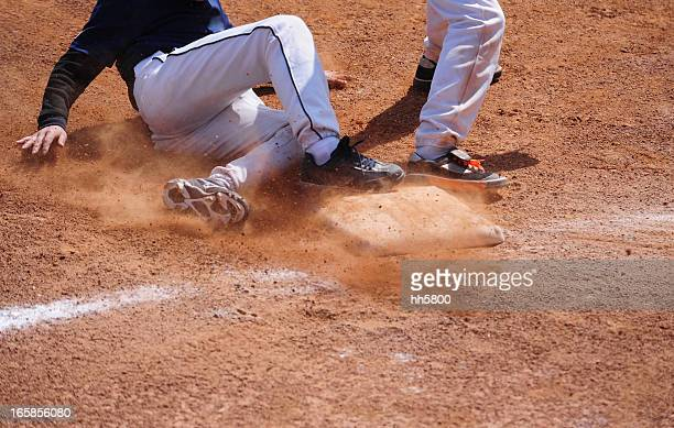 Baseball Player running  sliding Into Base