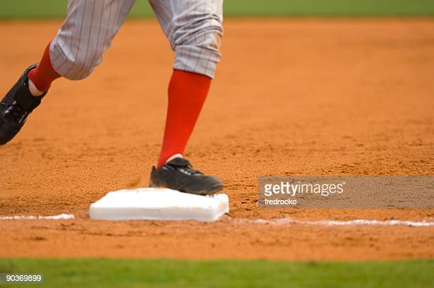 Baseball Player Running to First Baseball during Baseball Game