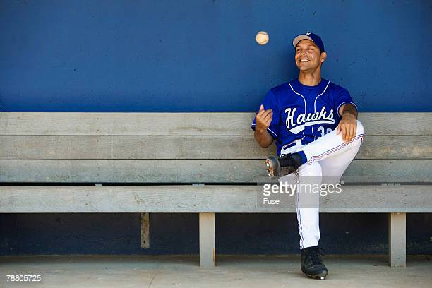 baseball player sitting in the dugout - ダグアウト ストックフォトと画像