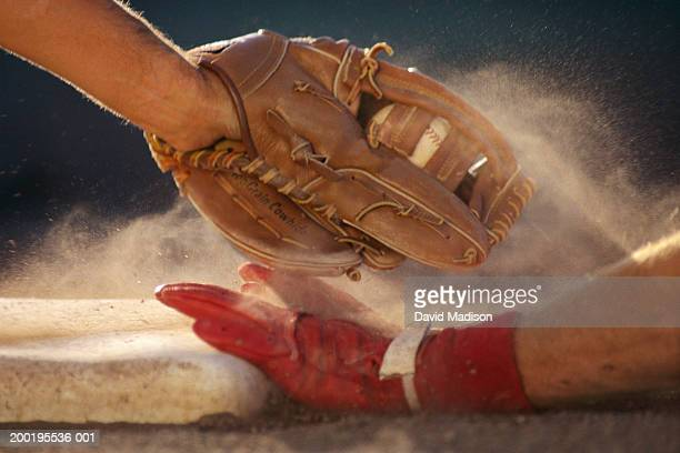 baseball player sliding into base, baseman tagging player, close-up - beisebol - fotografias e filmes do acervo