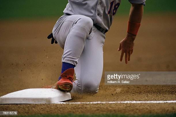 baseball player sliding into base - 塁 ストックフォトと画像