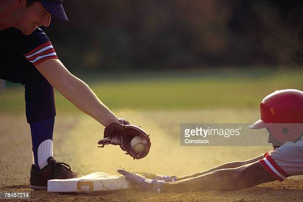 baseball player sliding into base - sliding stock pictures, royalty-free photos & images