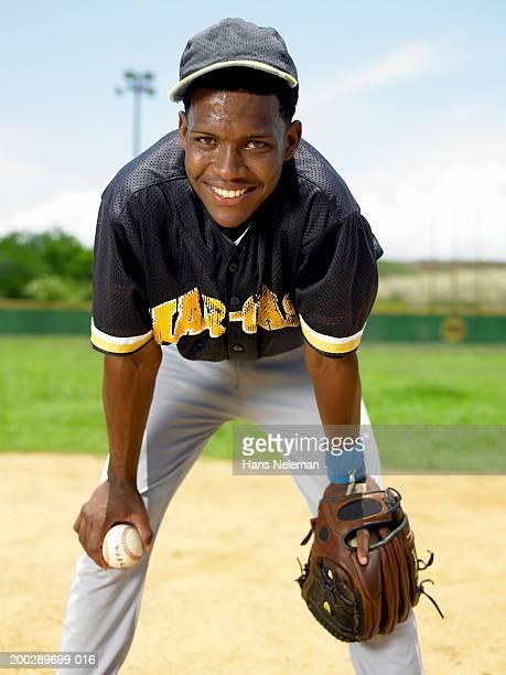 Baseball player smiling on baseball field, portrait