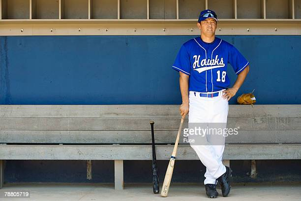 Baseball Player Standing in the Dugout