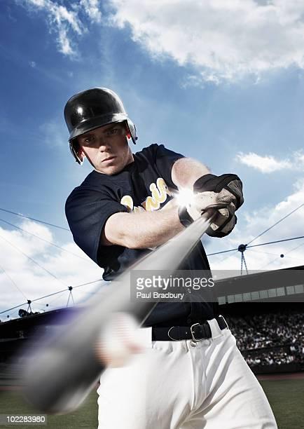 baseball player swinging baseball bat - batting stock pictures, royalty-free photos & images