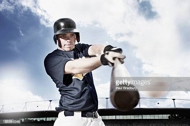 baseball player swinging baseball bat - batting stock pictures, royalty-free photos & images