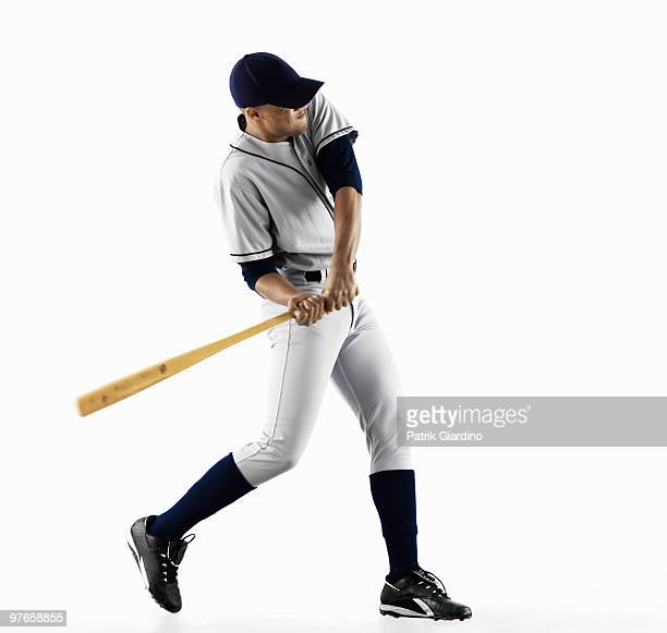 baseball player swinging bat - baseball player stock pictures, royalty-free photos & images