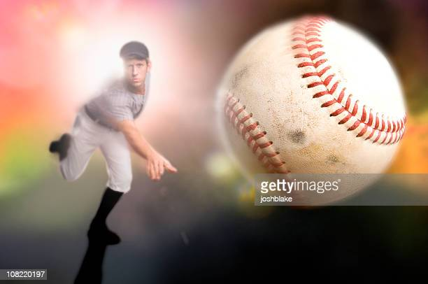 a baseball player throwing a ball - pitcher stockfoto's en -beelden