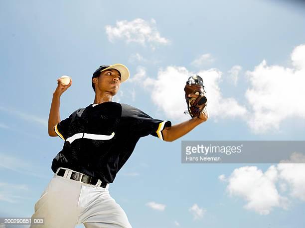Baseball player throwing ball, side view