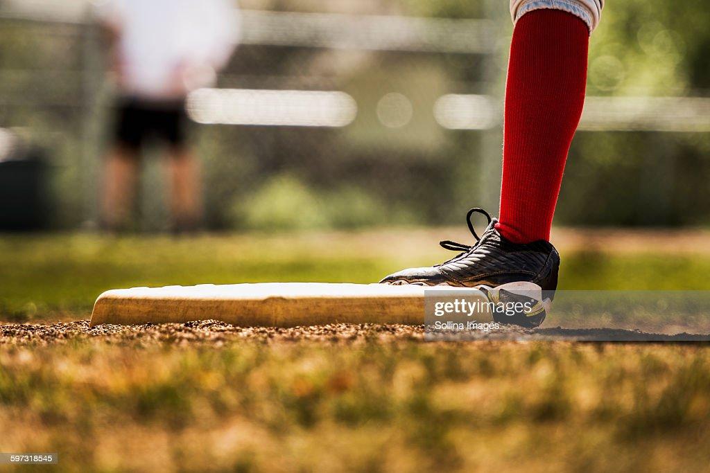 Baseball player touching base : Stock Photo