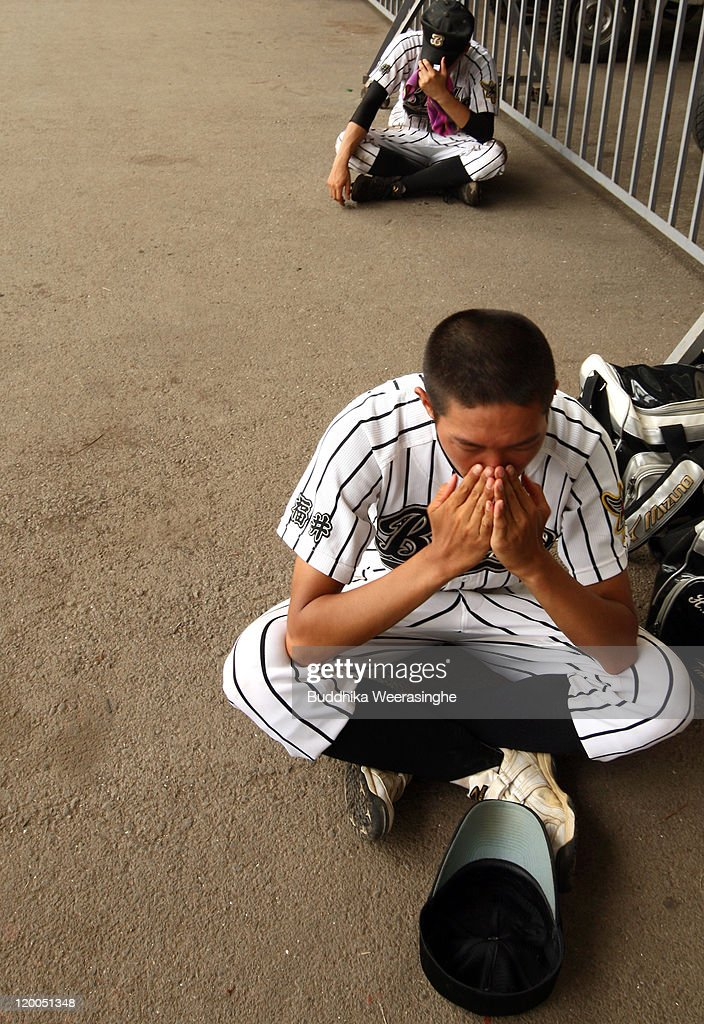 Baseball player weep after their team didn't qualify in the national tournament during the High School Baseball Tournament Fukui Prefecture semi final match at Fukui Prefecture Baseball Stadium on July 28, 2011 in Fukui, Japan. The high school baseball tournament, known as 'Koshien' in Japan, decides the champion of more than 4,000 teams nationwide. Koshien will be taking place from August 6 and will attract the attention of many Japanese.