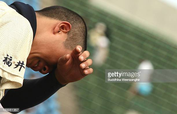 Baseball player weeps after their team didn't qualify in the national tournament during the High School Baseball Tournament at Fukui Prefecture...