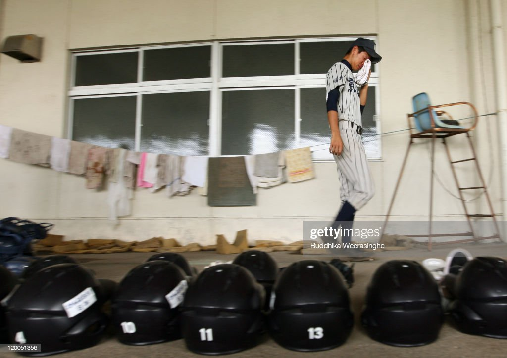 A baseball player weeps and walks over the gears after their team didn't qualify in the national tournament during the High School Baseball Tournament at Fukui Prefecture Baseball Stadium on July 28, 2011 in Fukui, Japan. The high school baseball tournament, known as 'Koshien' in Japan, decides the champion of more than 4,000 teams nationwide. Koshien will be taking place from August 6 and will attract the attention of many Japanese.
