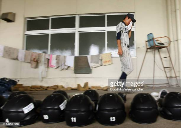 Baseball player weeps and walks over the gears after their team didn't qualify in the national tournament during the High School Baseball Tournament...