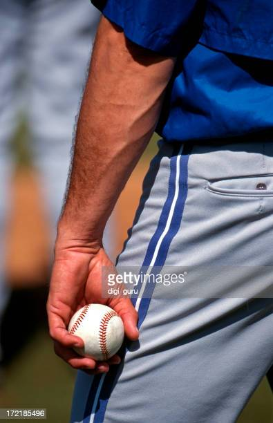 A baseball player with a ball in his hand ready to pitch