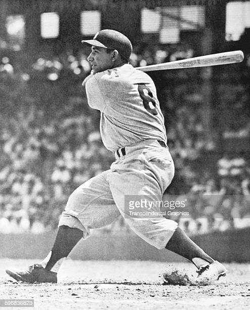 Baseball player Yogi Berra hits a ball during a game at Comisky Park Chicago Illinois 1958
