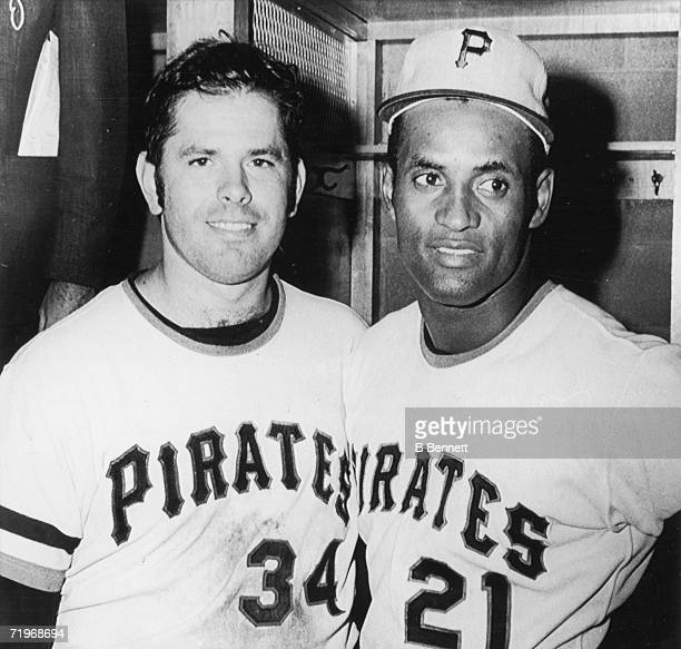 Baseball players and teammates Nelson Briles and Roberto Clemente of the Pittsburgh Pirates pose together in the locker room of Three Rivers Stadium...