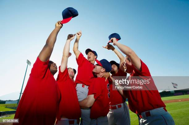 baseball players celebrating - baseball team stock pictures, royalty-free photos & images