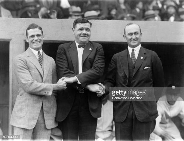 Baseball players George Sisler, Babe Ruth, and Ty Cobb attending the World Series on October 4, 1924 on the field in his New York Yankees uniform in...