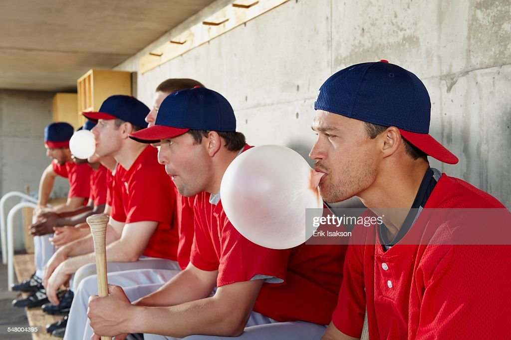 Baseball players in dugout : Stockfoto