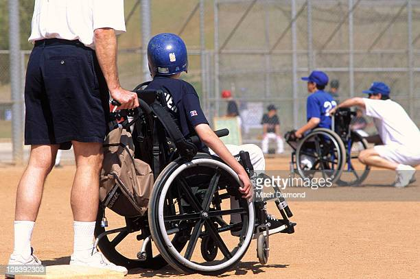 Baseball players in wheelchairs