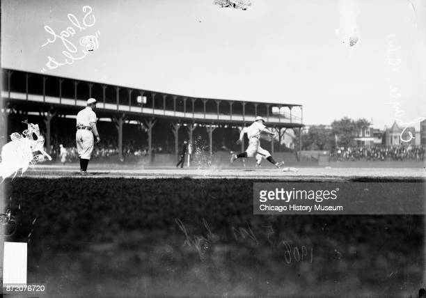 Baseball players Jimmy Slagle and Frank Chance both from the Chicago Cubs on the field during a game at West Side Grounds Chicago Illinois 1908