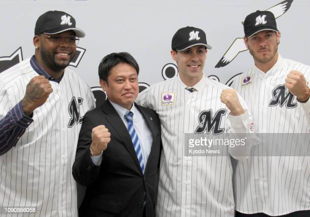 Baseball players Kennys Vargas of Puerto Rico and Brandon Mann and Josh Ravin of the United States pose for photos with Naoki Matsumoto Lotte Marines...