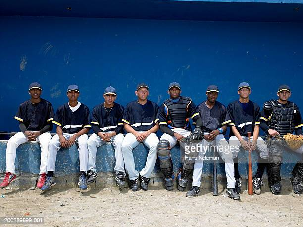 Baseball players sitting in dugout, portrait