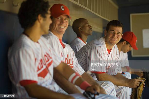 Baseball Players Sitting in the Dugout